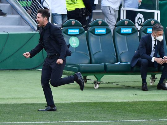 Atletico Madrid coach Diego Simeone celebrates.