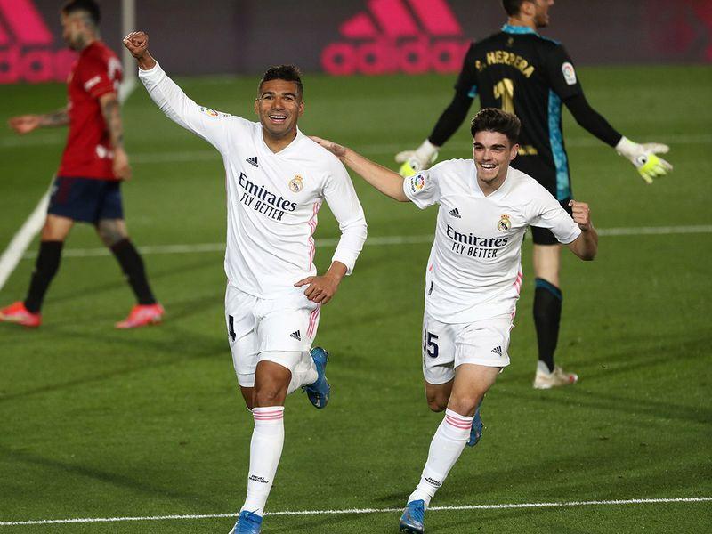 Real Madrid's Casemiro celebrates scoring their second goal with Miguel Ortega Gutierrez.