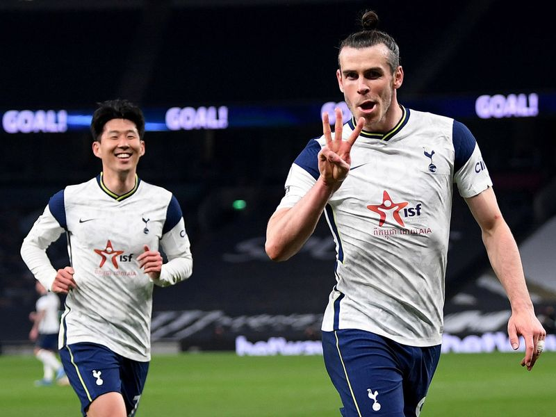 Gareth Bale celebrates hat trick for Tottenham Hotspur with teammate Son Heung-min.