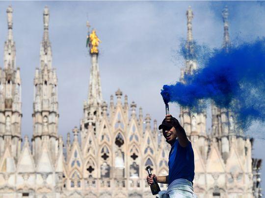 Inter Milan fans celebrate winning Serie A outside the Duomo di Milano.