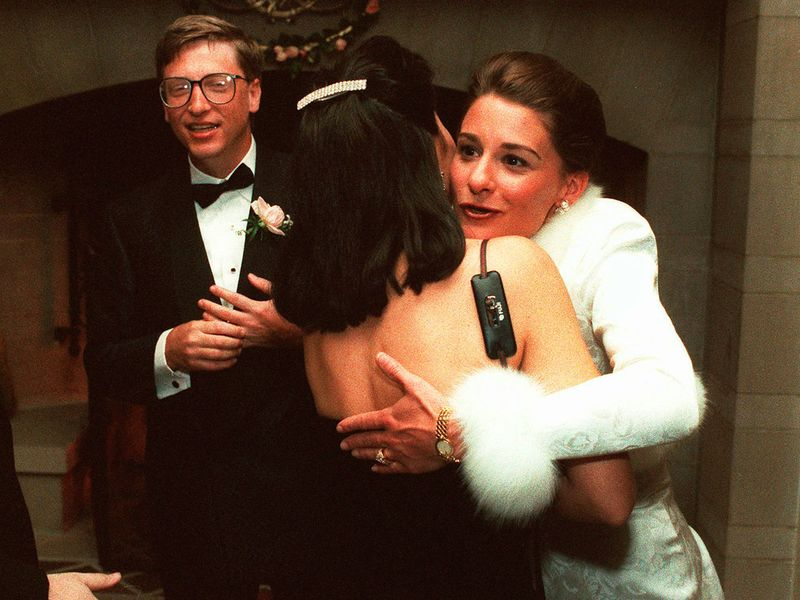 In this Jan. 9, 1994, file photo, computer mogul Bill Gates III and bride Melinda French greet guests in a reception line at a private estate in Seattle.