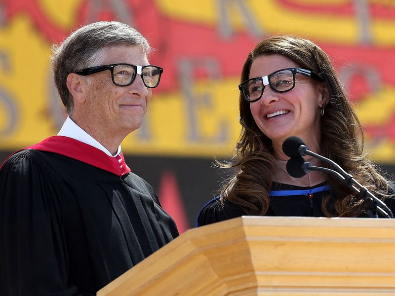 In this file photo taken on June 14, 2014 Microsoft founder and chairman Bill Gates shares the stage with his wife Melinda during the 123rd Stanford commencement ceremony in Stanford, California.