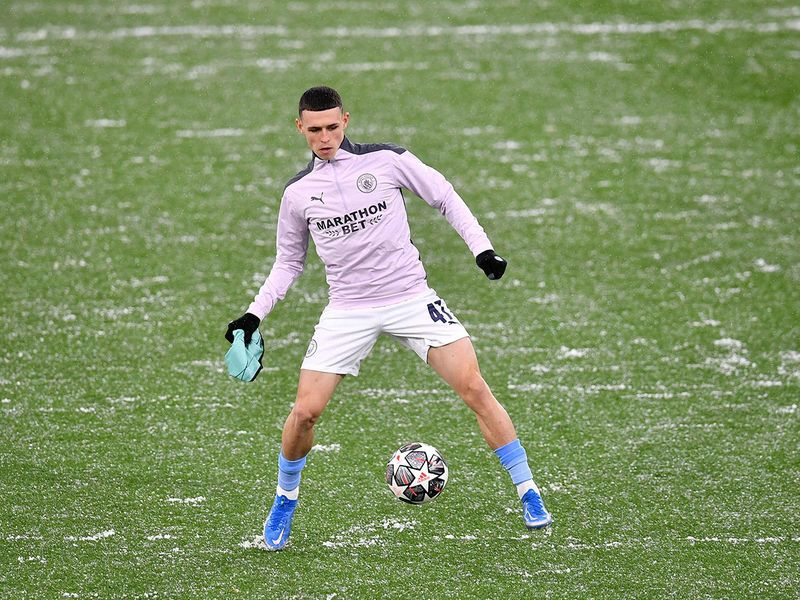 Manchester City's Phil Foden warms up