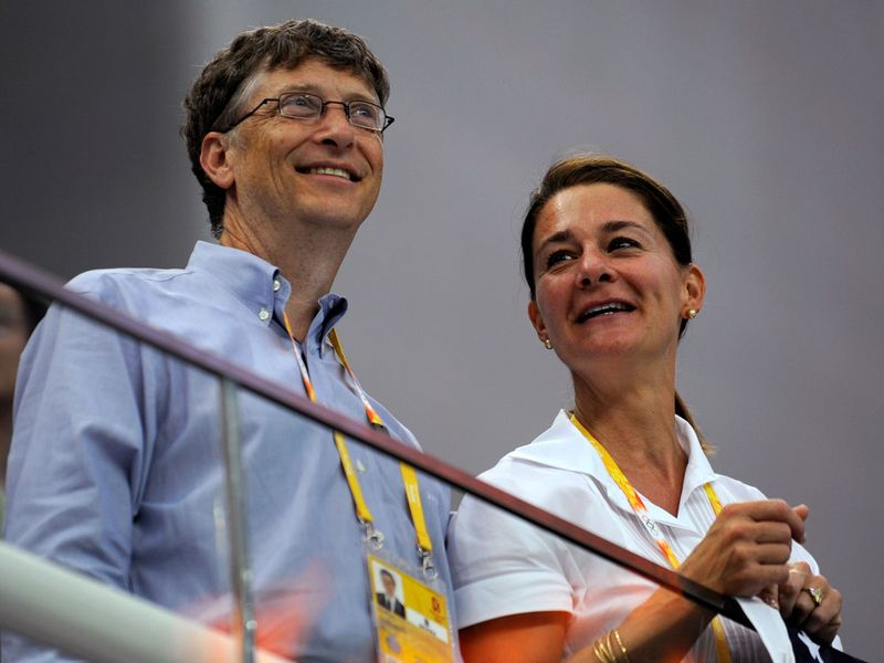 Microsoft Corp co-founder Bill Gates (L) and his wife Melinda Gates watch the swimming events at the National Aquatics Center during the Beijing 2008 Olympic Games, in Beijing, China August 10, 2008.