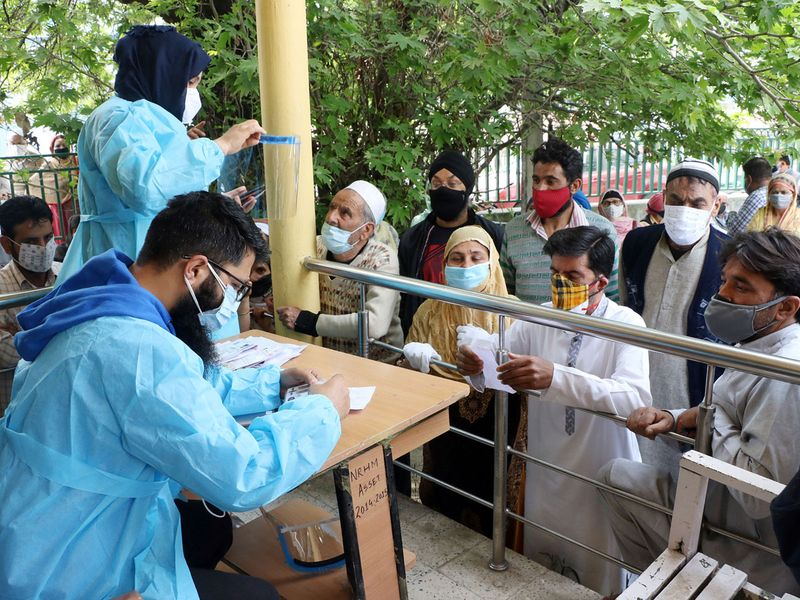 A health worker administrator registered people before a COVID-19 vaccine, amidst the spread of the coronavirus disease (COVID-19),at Jawahar Nagar center in Srinagar on Wednesday.