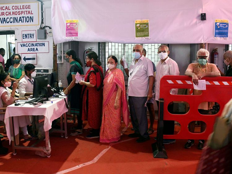 People wait in a queue to receive the dose of the Covid-19 vaccine,  at Nair hospital in Mumbai on Wednesday.