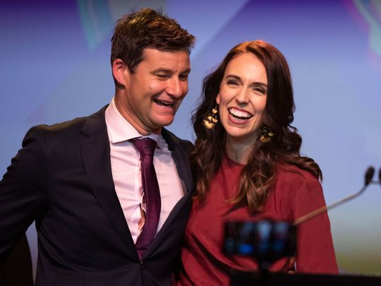 New Zealand Prime Minister Jacinda Ardern, right, is congratulated by her partner Clarke Gayford following her victory speech to Labour Party members at an event in Auckland, New Zealand.