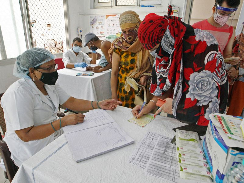 Uttar Pradesh, May 05 (ANI): A health worker administrator registered people before a COVID-19 vaccine, amidst the spread of the coronavirus disease (COVID-19),at Beli hospital in Prayagraj on Wednesday.