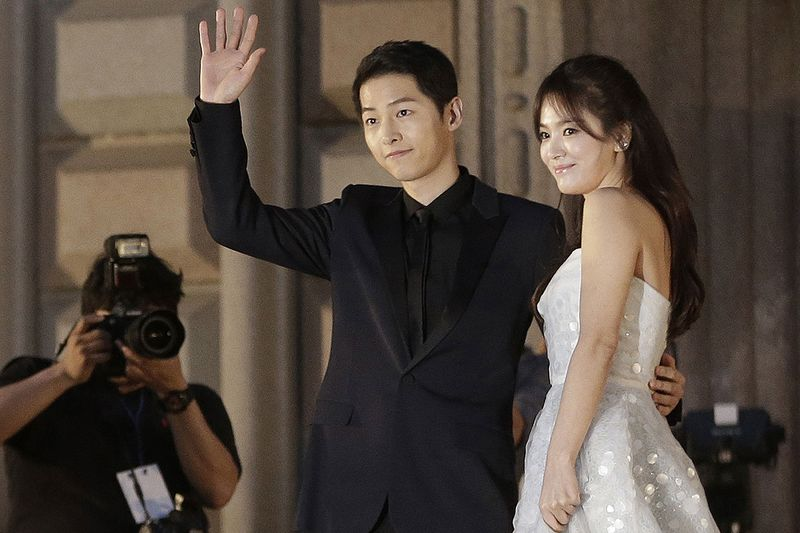 In this June 3, 2016 file photo, South Korean actress Song Hye-kyo, right, and actor Song Joong-ki pose as they arrive for the Baeksang Arts Awards in Seoul, South Korea.