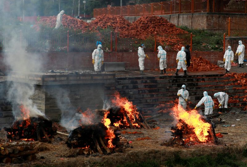 Photos: Nepal overwhelmed by surge of COVID-19 infections