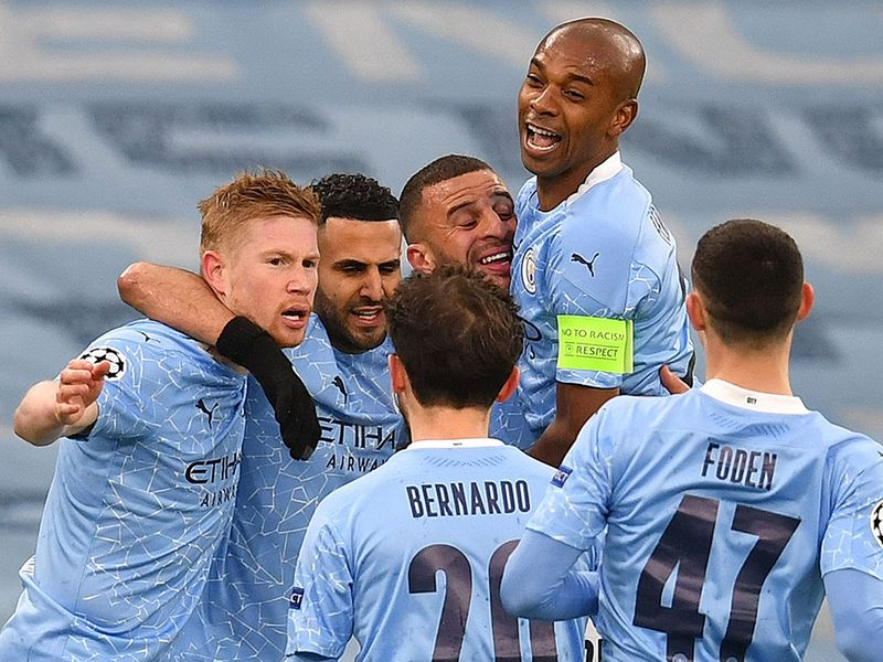 Manchester City celebrate winning against PSG in the Champions League.