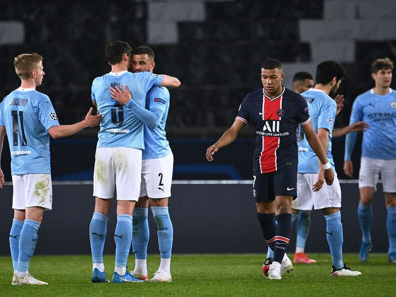 PSG's Kylian Mbappe looks dejected as Manchester City celebrate their Champions League win.
