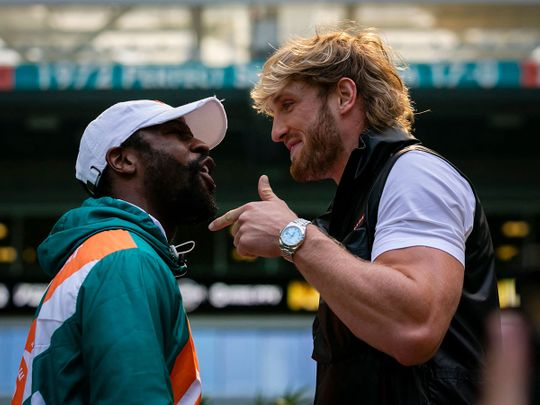Floyd Mayweather and Logan Paul face-off during a press conference at Hard Rock Stadium, in Miami Gardens