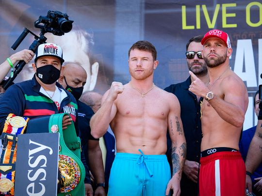 Canelo Alvarez and Billy Joe Saunders pose for the fans during weigh ins for their super middleweight boxing title fight at AT&T Stadium.
