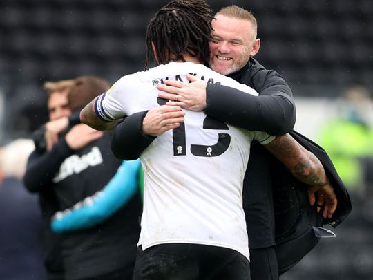 Derby County manager Wayne Rooney celebrates with Colin Kazim-Richards after the match with Sheffield Wednesday