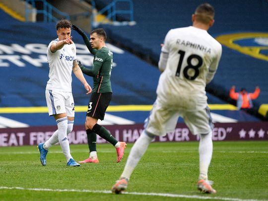 Leeds United's Rodrigo, left, and Raphinha celebrate against Tottenham
