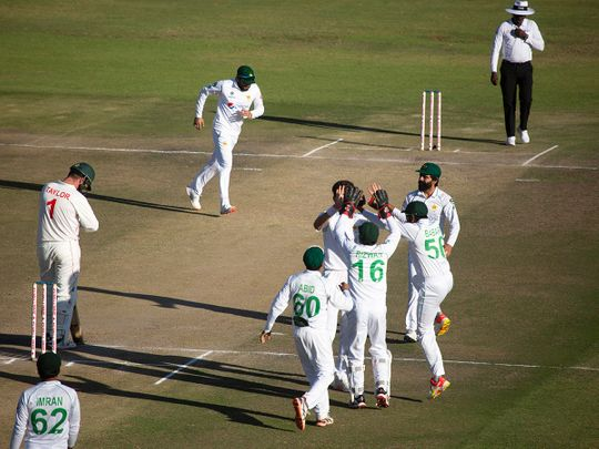 Pakistan players celebrate the wicket of Zimbabwean captain Brendan Taylor