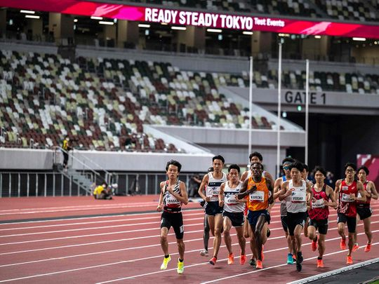Athletes compete the men's 5,000m race during an athletics test event for the 2020 Tokyo Olympics at the National Stadium