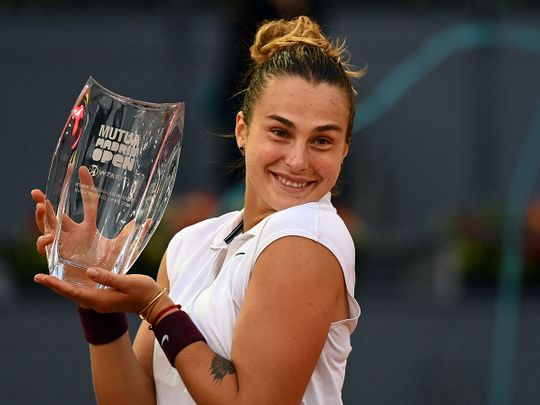 Belarus' Aryna Sabalenka poses with her trophy after beating Australia's Ashleigh Barty during their 2021 WTA Tour Madrid Open tennis tournament singles final match at the Caja Magica in Madrid on May 8, 2021.
