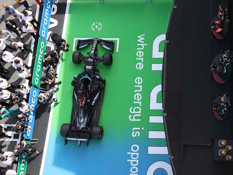 Lewis Hamilton is congratulated by his Mercedes team