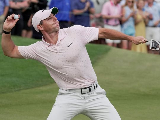 Rory McIlroy throws his ball into the crows after winning the Wells Fargo at Quail Hollow
