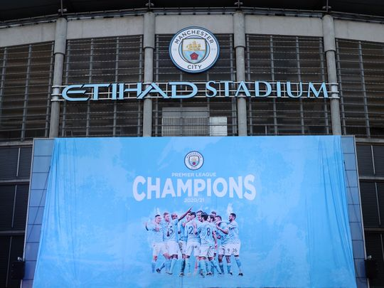 A flag is unfurled at Etihad Stadium proclaiming Manchester City as champions