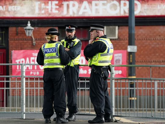 Police are deployed in force outside the Old Trafford stadium in Manchester, ahead of the English Premier League match against Leicester City