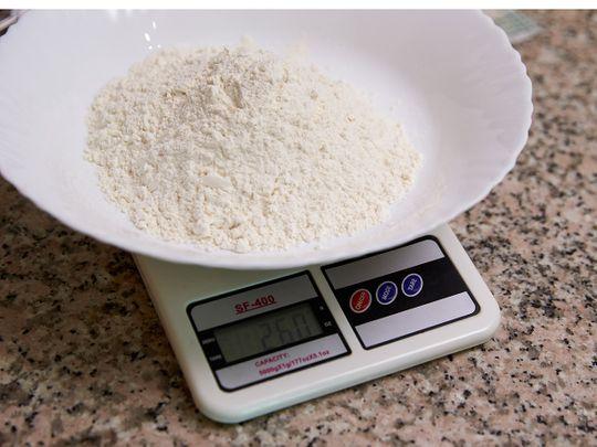 Add white flour to a bowl