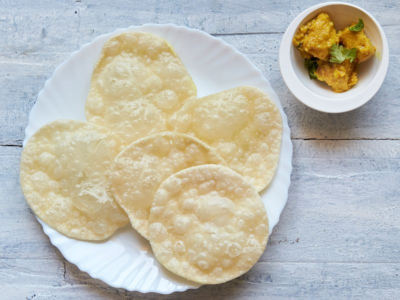 Serve hot with chicken korma or any other gravy