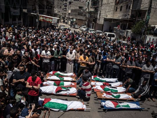 Palestinians perform funeral prayers for 8 children and 2 women of the Abu Hatab family killed by Israel on Saturday, May 15.