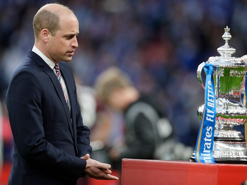 Britain's Prince William looks at the trophy just before the presentation after the FA Cup final.