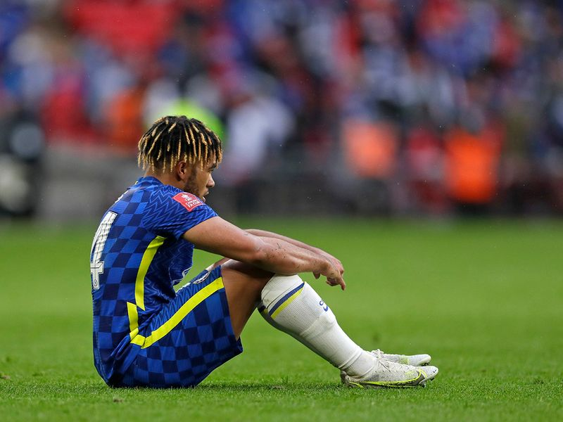 Chelsea's Reece James sits on the pitch after the FA Cup final. Leicester won the match 1-0.