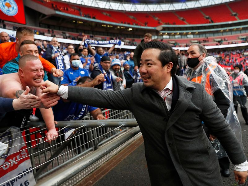 Leicester City chairman Aiyawatt Srivaddhanaprabha celebrates with the fans after winning the FA Cup final.