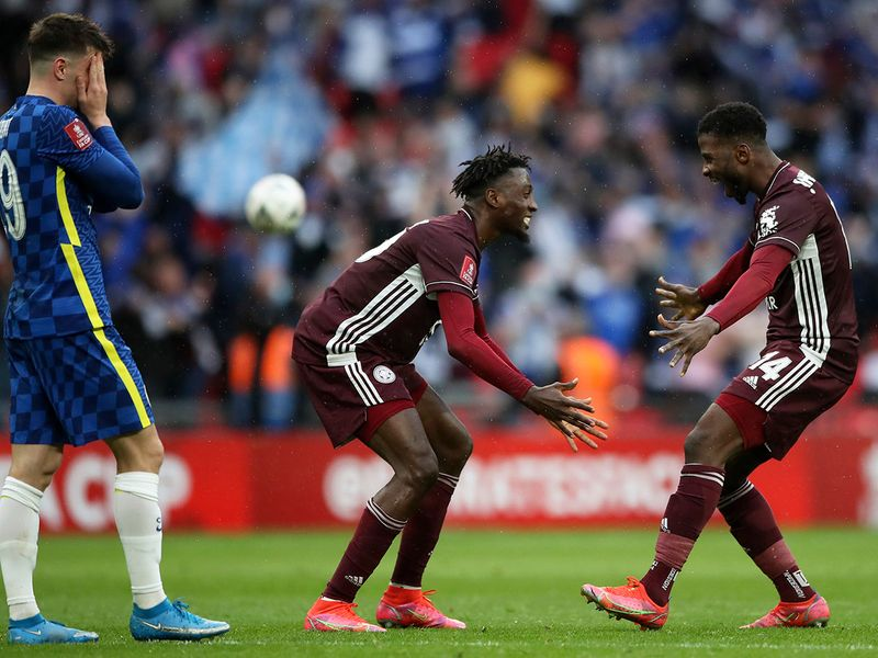 Leicester's Kelechi Iheanacho, right, and Wilfred Ndidi celebrate while Chelsea's Mason Mount, left, reacts at the end of the FA Cup final.