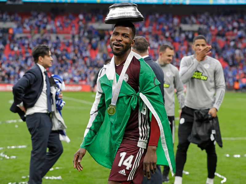 Leicester's Kelechi Iheanacho celebrates with the trophy stand on his head at the end of the FA Cup final.