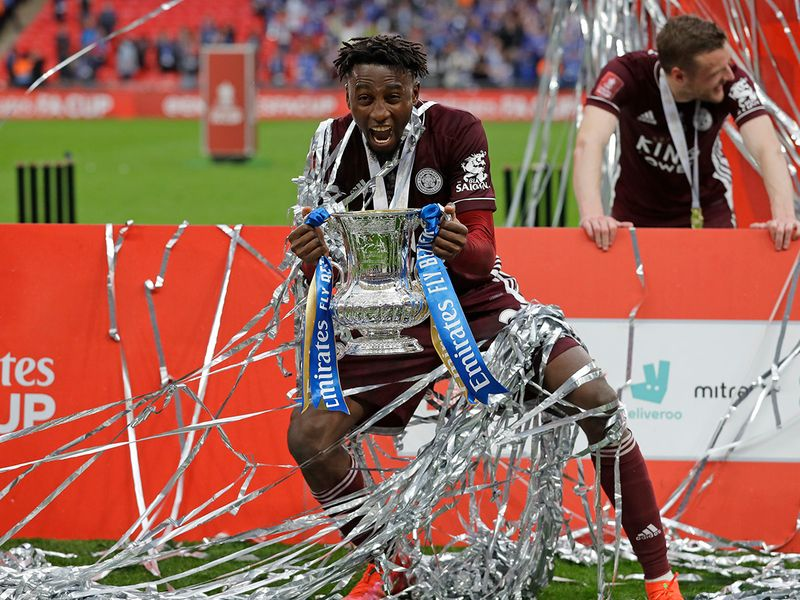 Leicester's Wilfred Ndidi celebrates at the end of the FA Cup final.
