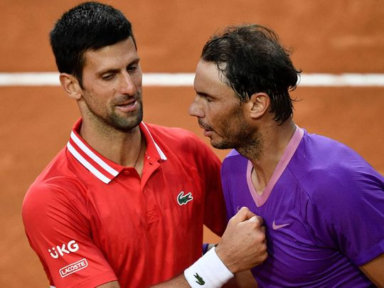 Novak Djokovic congratulates Rafael Nadal after the Italian Open final