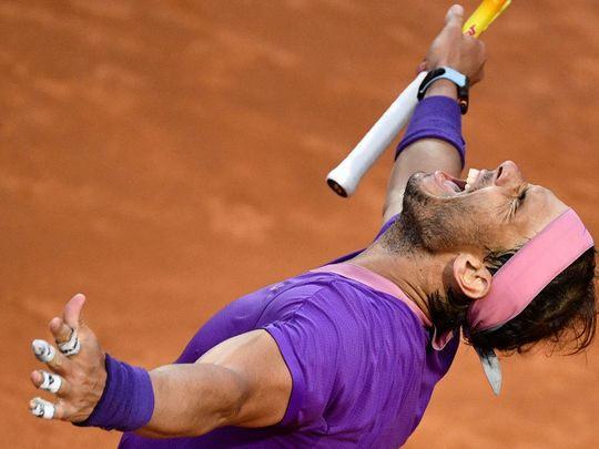 Spain's Rafael Nadal celebrates after defeating Serbia's Novak Djokovic during the final of the Italian Open