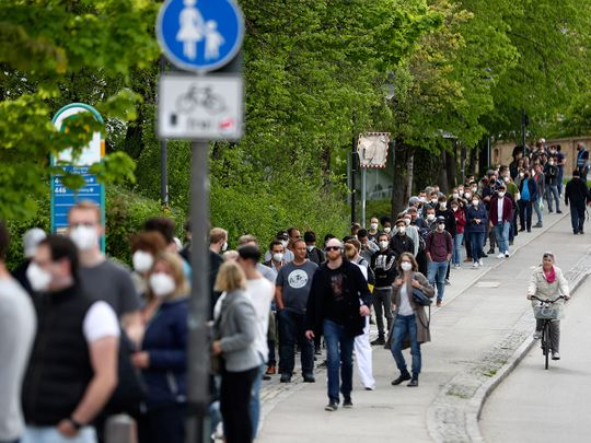People queue at a vaccination centre in Ebersberg near Munich, Germany.