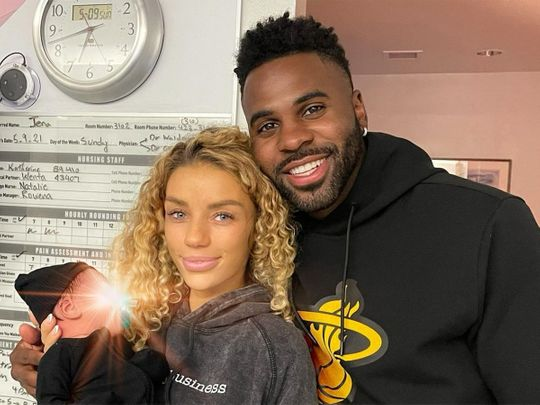 Jason Derulo and girlfriend Jena Frumes with their son