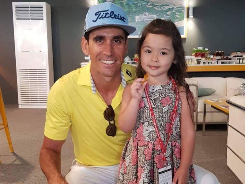 Rafa Cabrera-Bello with a young fan, Alex, at the Omega Dubai Desert Classic