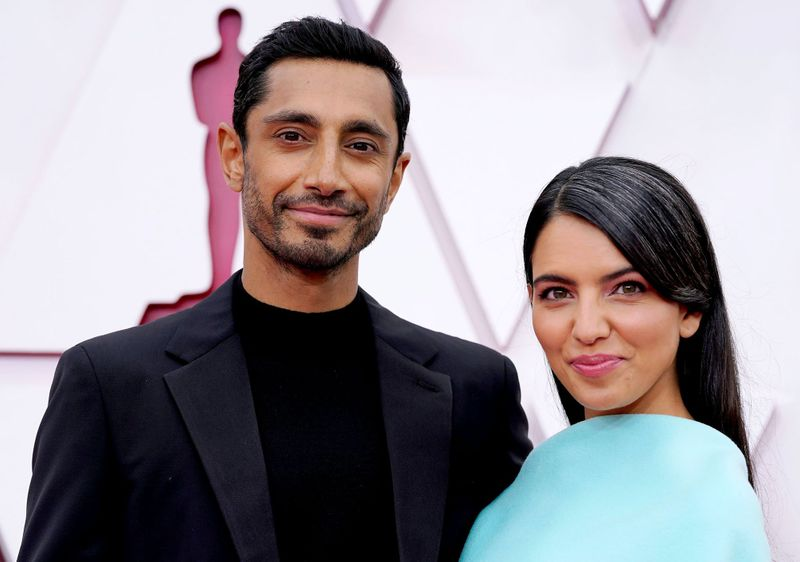 Riz Ahmed, left, and Fatima Farheen Mirza arrive at the Oscars on Sunday, April 25, 2021, at Union Station in Los Angeles