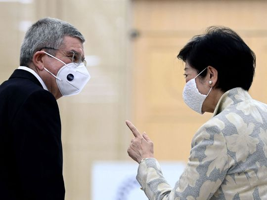 Tokyo Governor Yuriko Koike speaks to International Olympic Committee president Thomas Bach