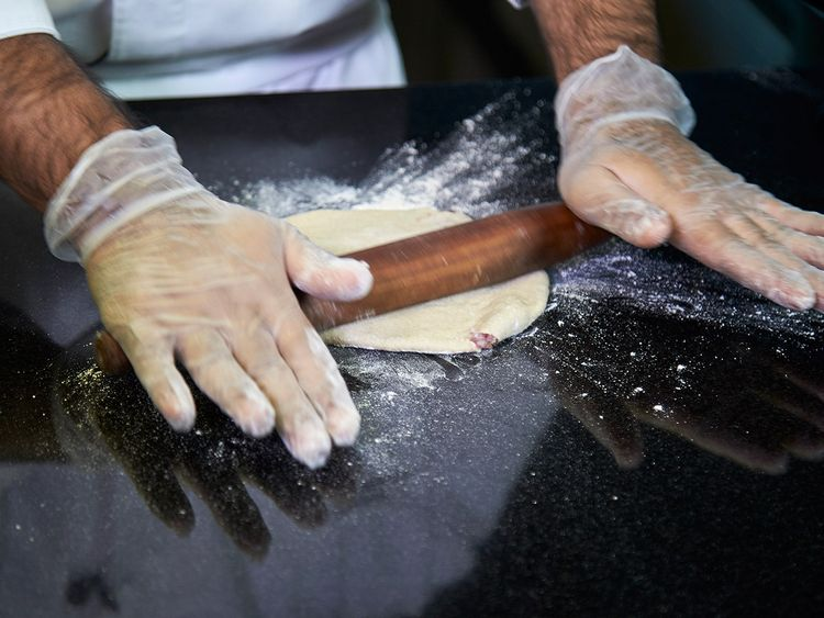 Make sure the you put equal pressure on both sides of the rolling pin, to press the filled dough evenly