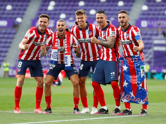 Atletico players celebrate the title
