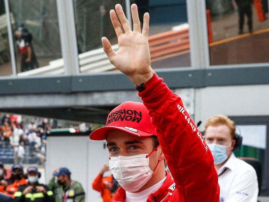 Ferrari's Monaco driver Charles Leclerc celebrates pole position