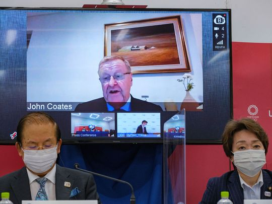 CEO of the Tokyo 2020 Toshiro Muto, left, and President of the Tokyo 2020 Seiko Hashimoto, right, listen to IOC Vice President  John Coates, (on screen), delivering a speech during the Tokyo 2020 IOC Coordination Commission press conference in Tokyo.