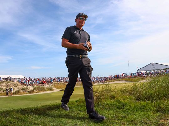 Phil Mickelson walks off the 10th tee during the third round of the 2021 PGA Championship at Kiawah Island