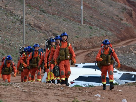 Rescuers walk into the accident site to search for mountain marathon survivors in Jingtai County of Baiyin City, northwest China's Gansu Province