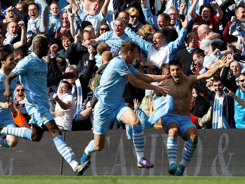 Sergio Aguero scores the winning goal against QPR to claim the 2011-12 Premier League title